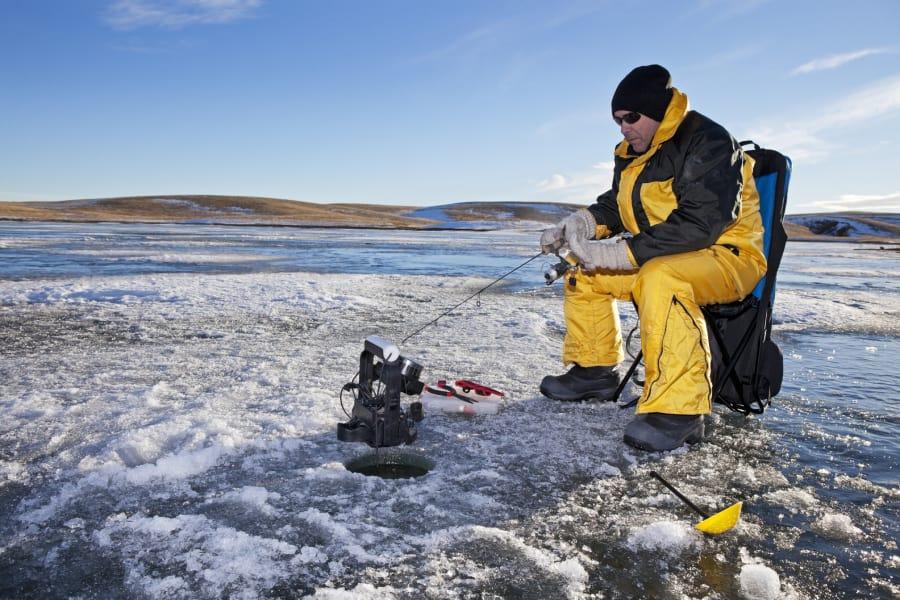 Ice fishing frozen lake
